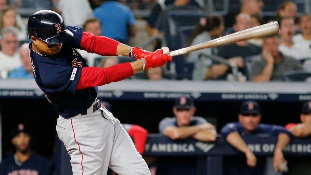 Boston Red Sox right fielder Mookie Betts singles against the New York Yankees during the third inning at Yankee Stadium